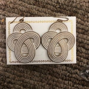 White brushed swirling earrings